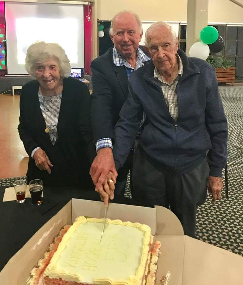 Merv and Rae Edwards with Barry Cox cutting the 55 year cake